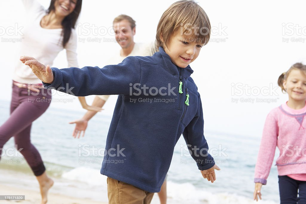 Family Playing On Beach Together royalty-free stock photo