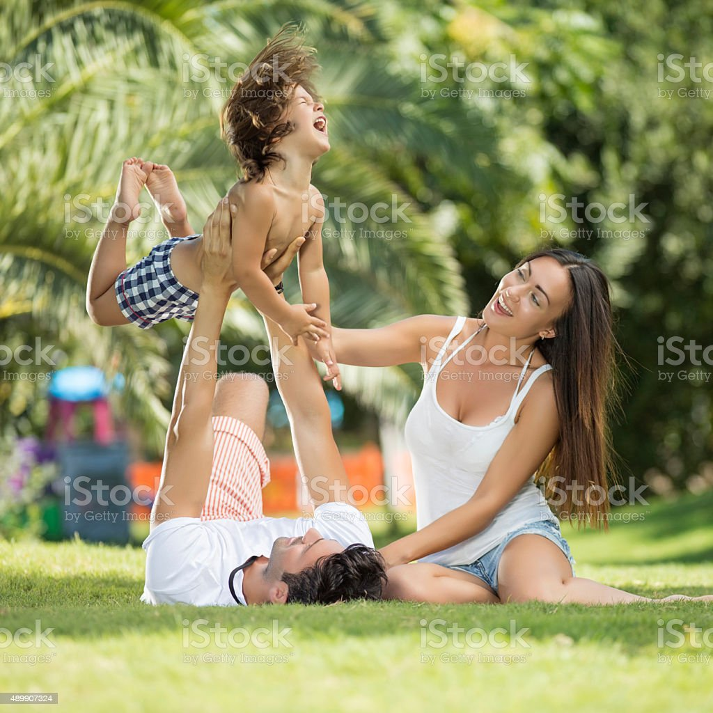 Family playing on garden stock photo