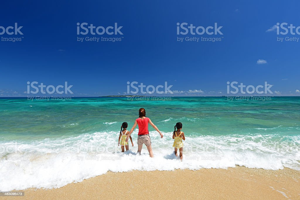 Family playing on the beach in Okinawa stock photo