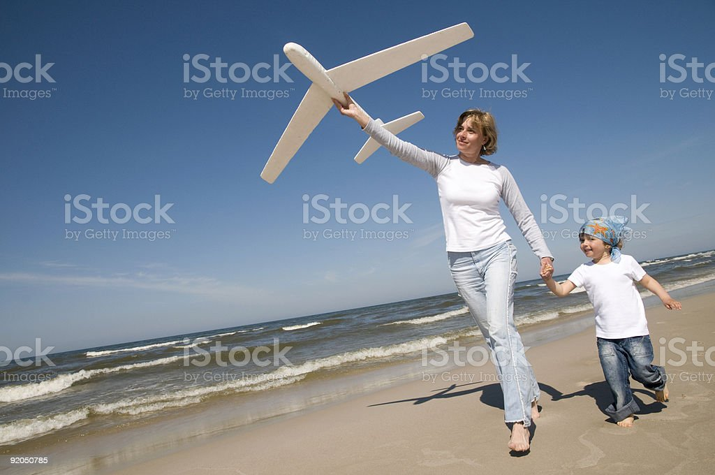 Family playing on the beach royalty-free stock photo