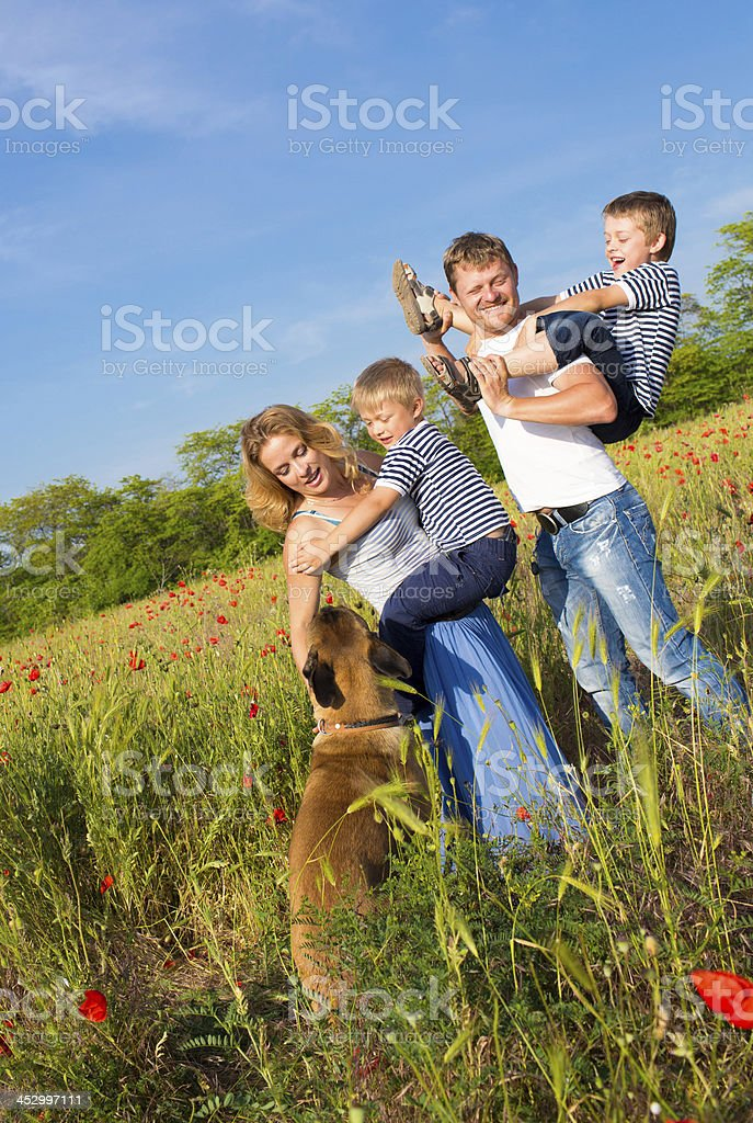 Family playing on the meadow royalty-free stock photo