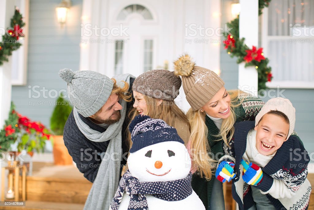 Family playing outdoors. stock photo