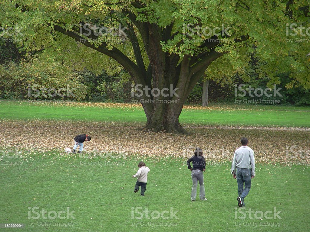 Family Playing Underneath The Big Tree royalty-free stock photo