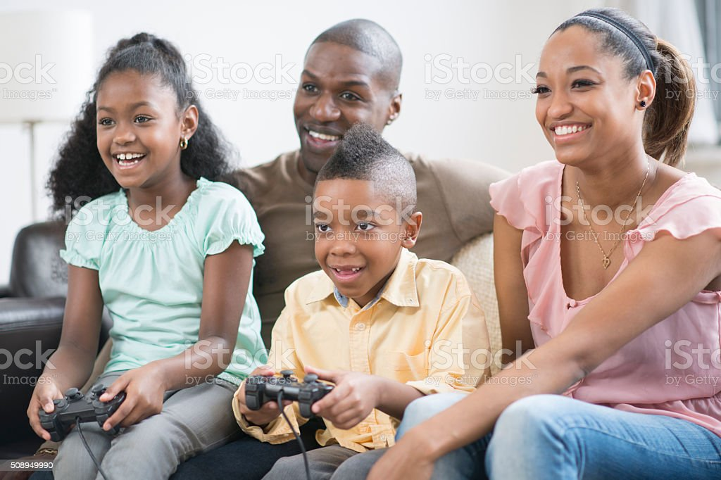Family Playing Video Games Together stock photo