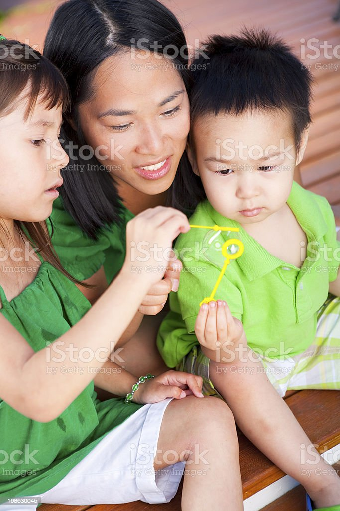 Family playing with bubbles royalty-free stock photo