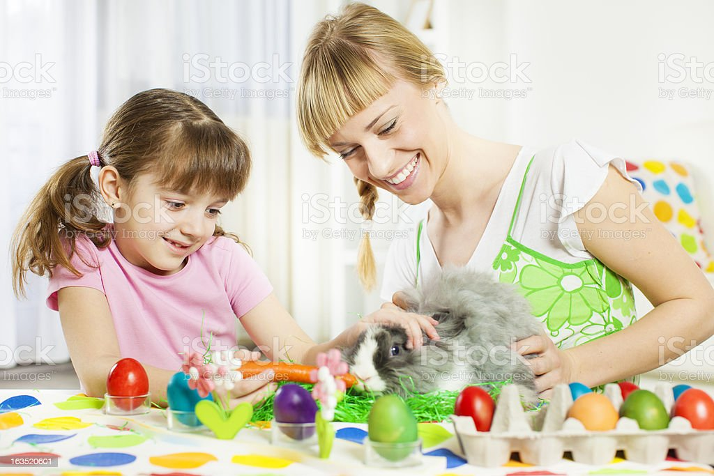 Family Playing With Easter Bunny. royalty-free stock photo