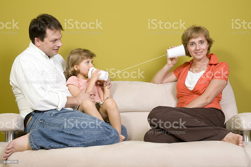 Family playing with mug phone royalty-free stock photo