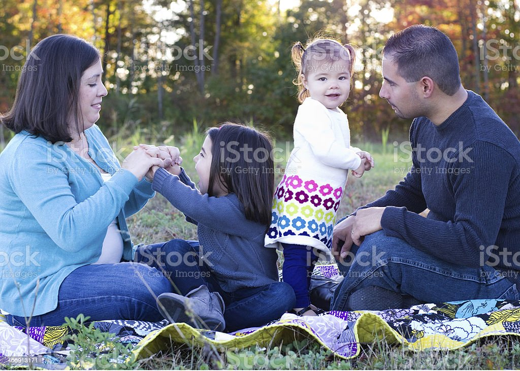 Family plays games together outside stock photo