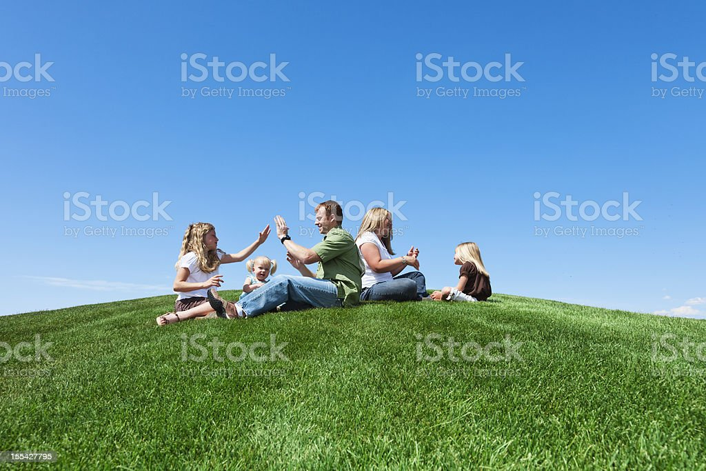 Family Playtime in The Park royalty-free stock photo