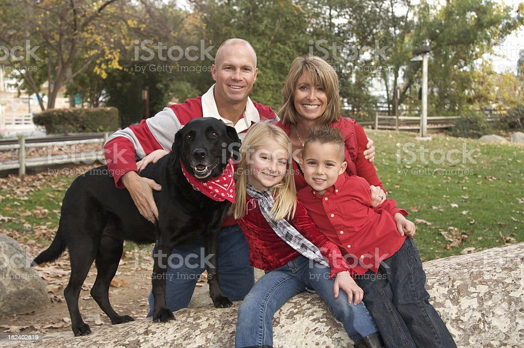 Family Portrait at the Park with Their Dog royalty-free stock photo