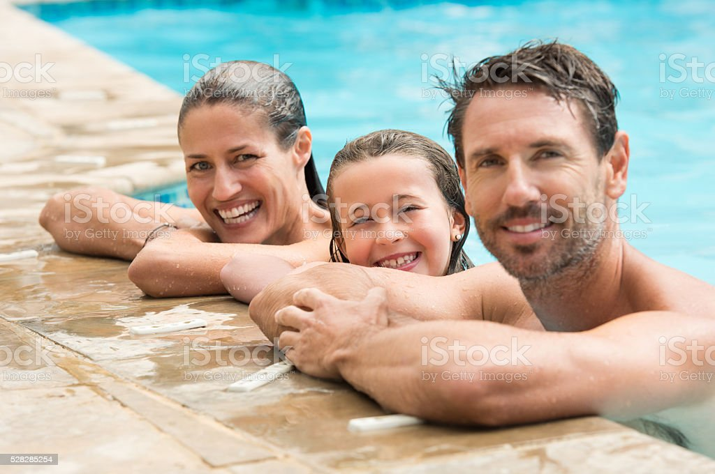 Family portrait in swimming pool stock photo
