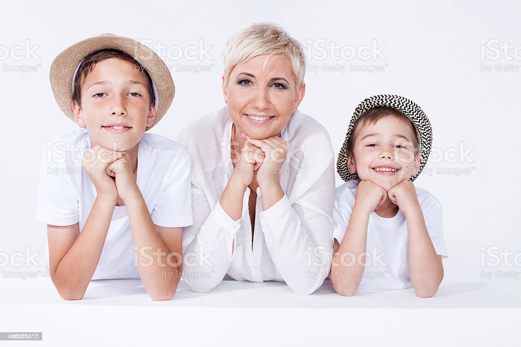 Family portrait, mother with sons. stock photo
