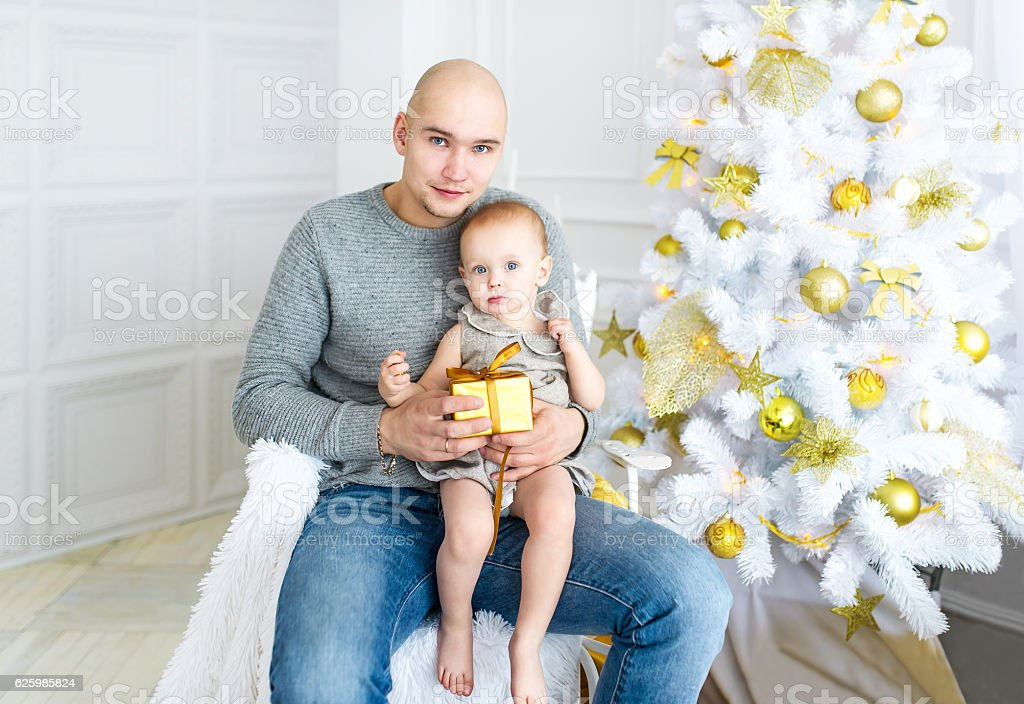 Family portrait of father and baby daughter. Christmas. New year. stock photo