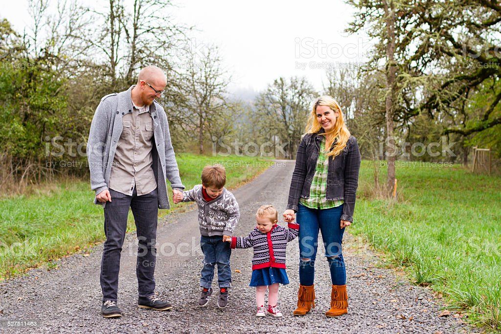Family Portrait of Four Outdoors stock photo