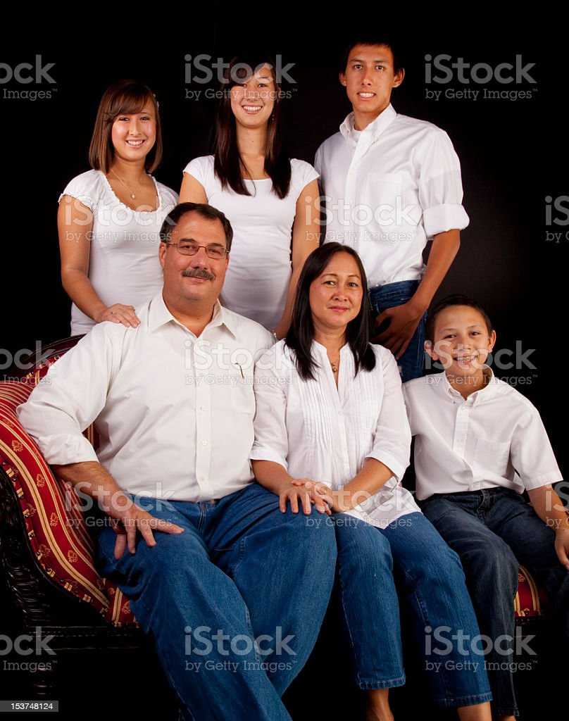Family portrait with mother, father, and four siblings stock photo