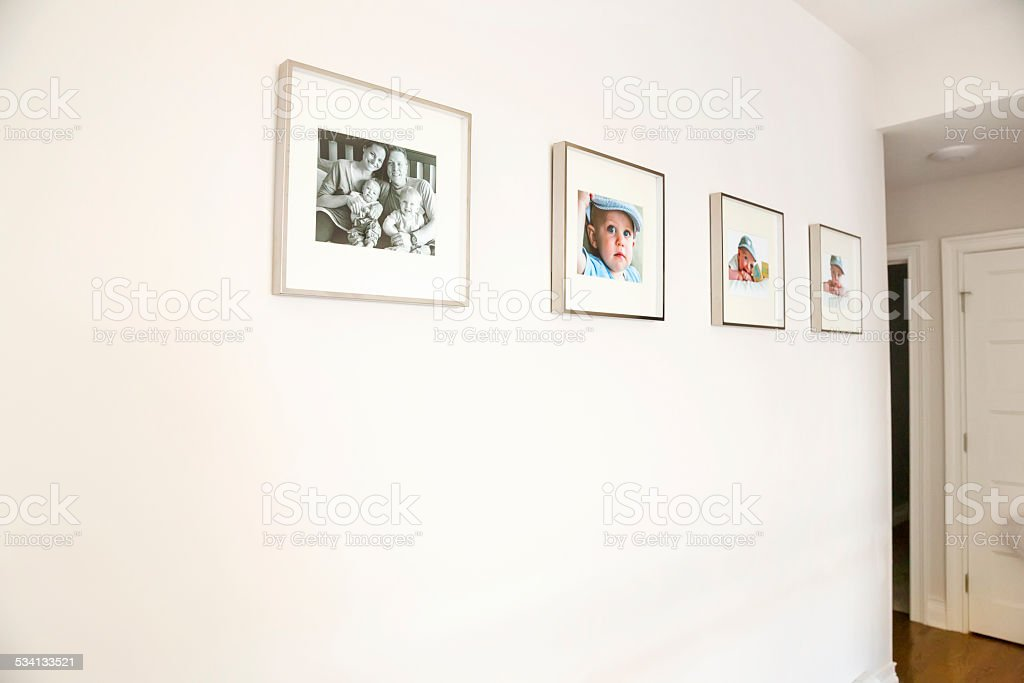 Family portraits hanging on a wall in a home stock photo