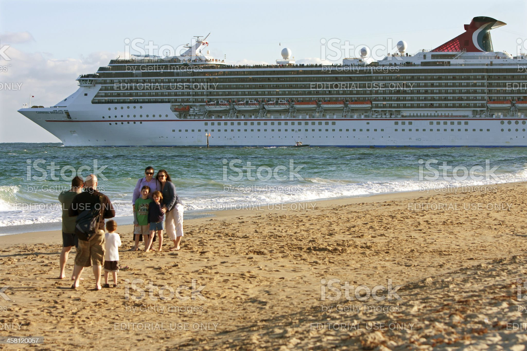 Family Poses For Picture With Cruise Ship Departing in Background royalty-free stock photo
