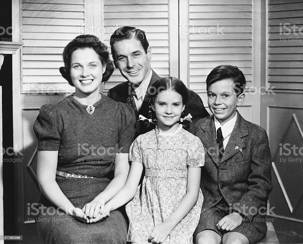 Family posing at home, children (8-9) (10-11), (B&W), portrait stock photo