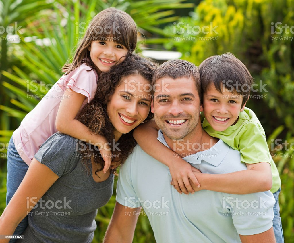 Family posing in front of the camera royalty-free stock photo