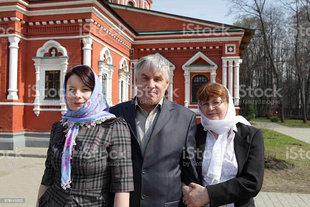 Family posing near church stock photo