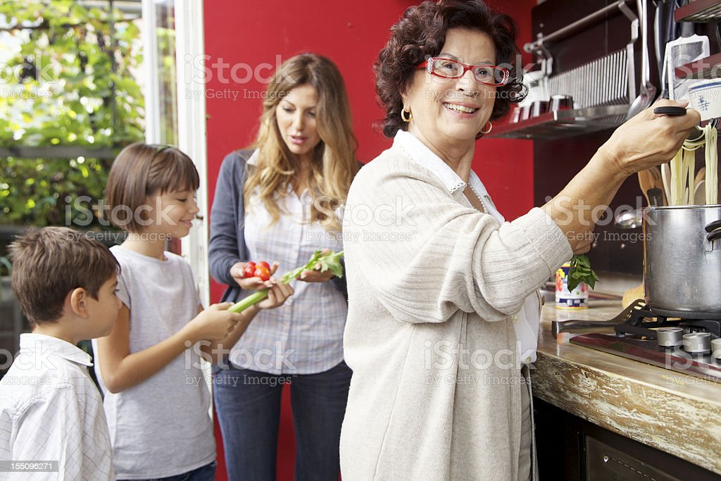 Family preparing a meal together. royalty-free stock photo
