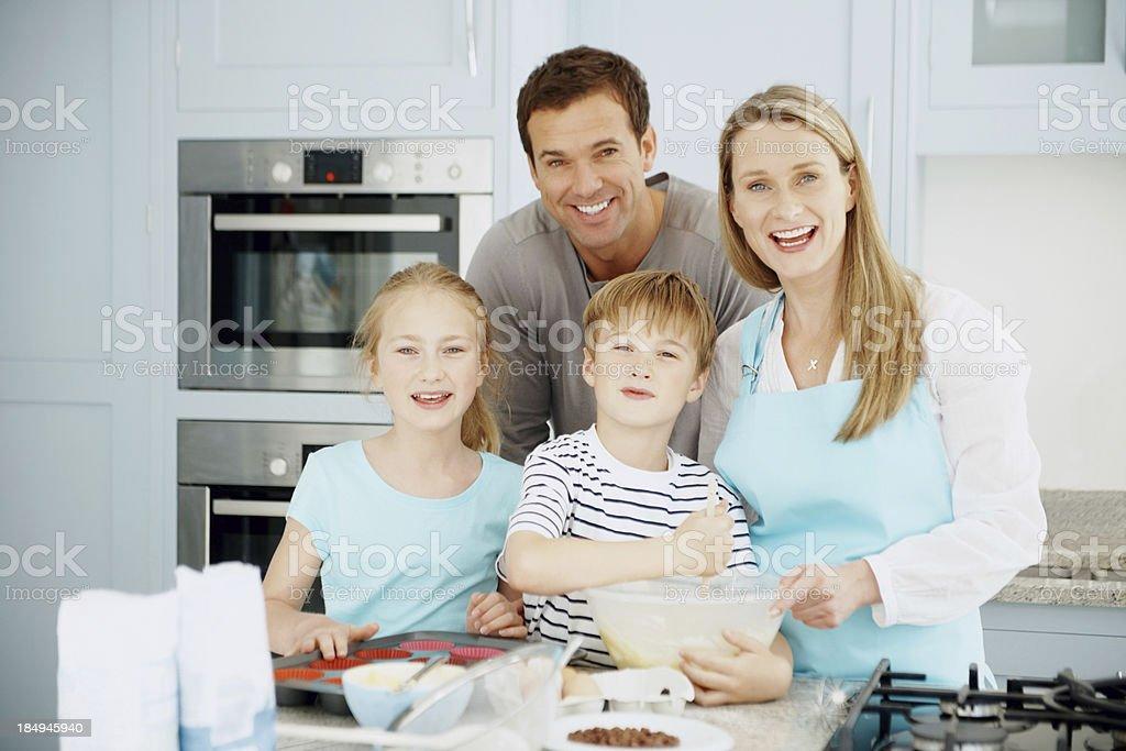Family preparing cake at home royalty-free stock photo