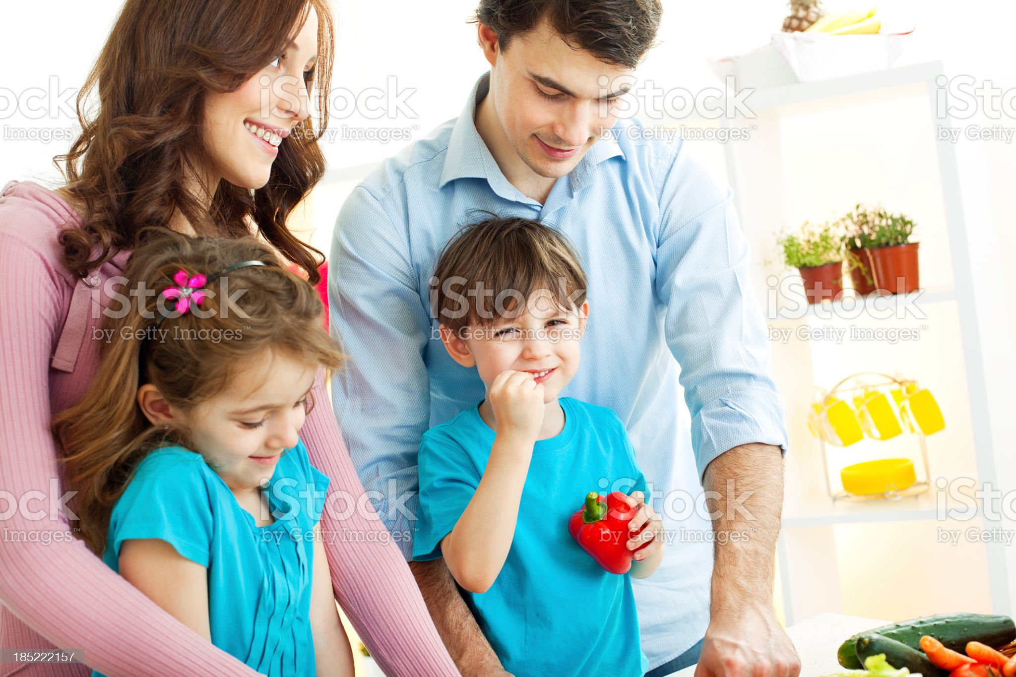 Family preparing food together royalty-free stock photo