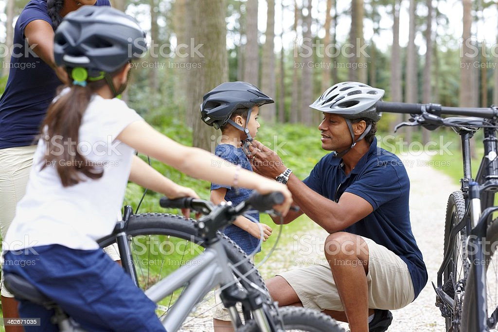 Family preparing for bicycle ride stock photo
