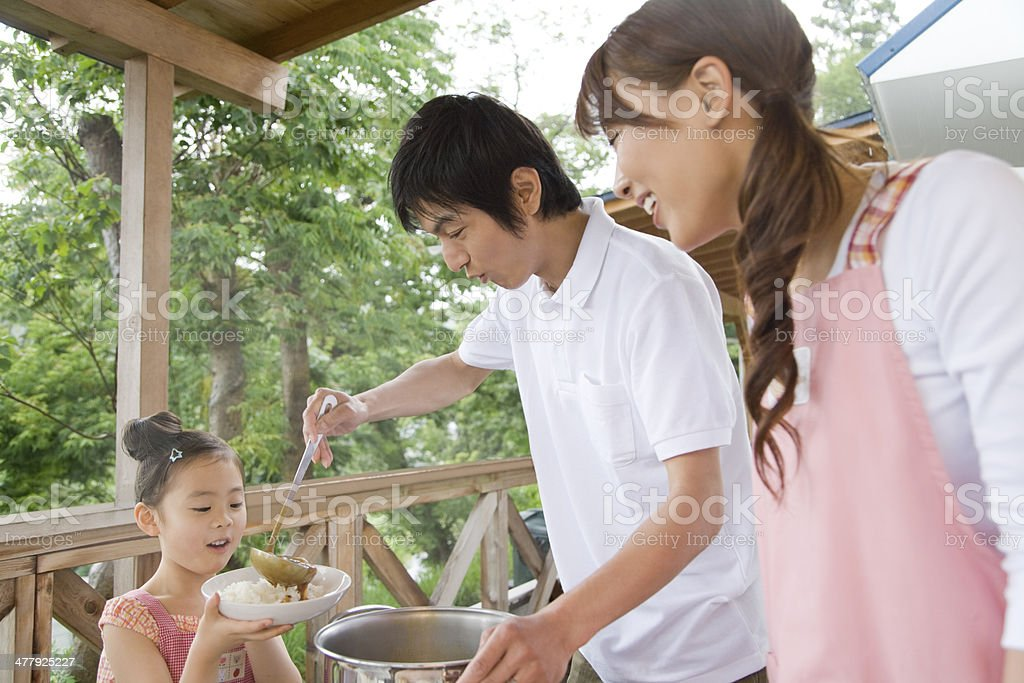 Family preparing for meal stock photo