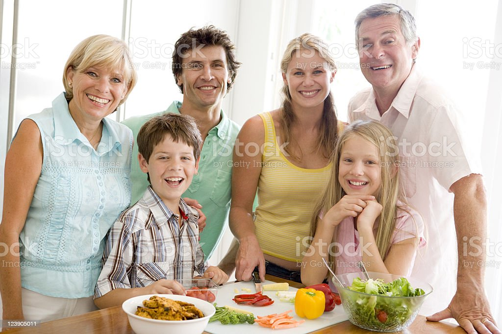 Family preparing meal together royalty-free stock photo