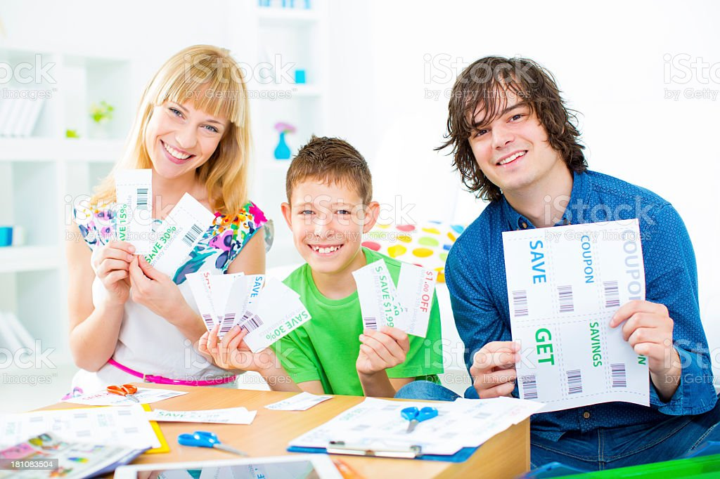 Family Preparing Shopping Coupons. stock photo