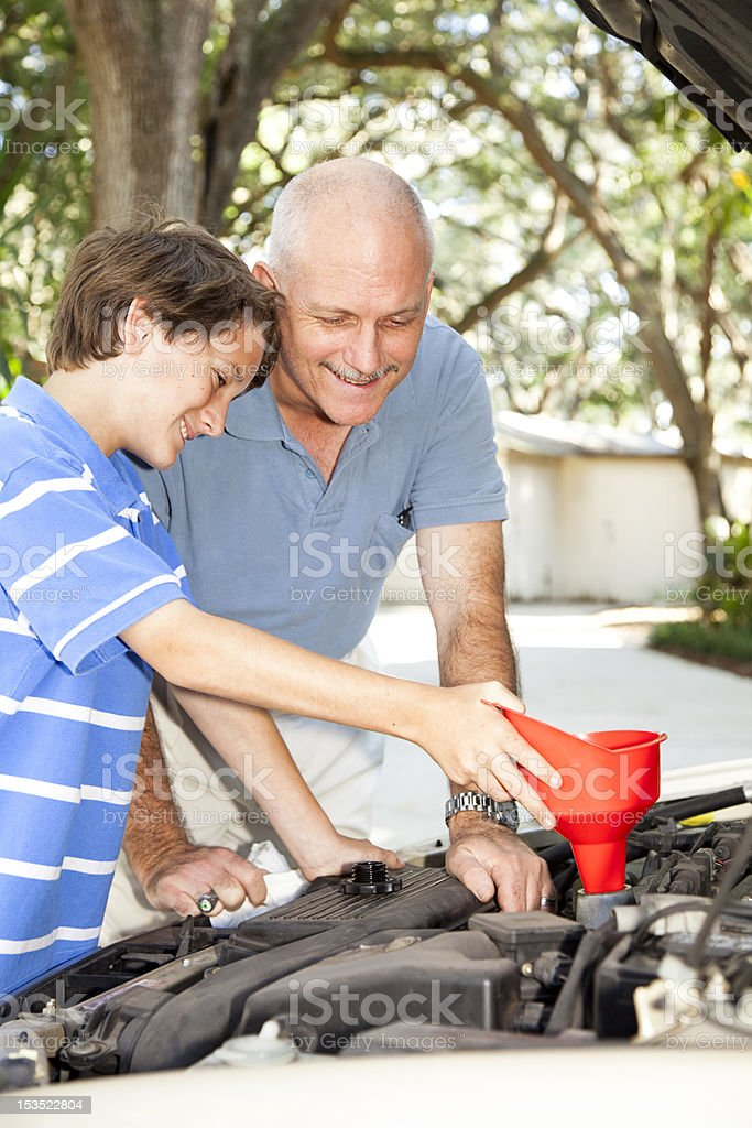 Family Project - Oil Change royalty-free stock photo