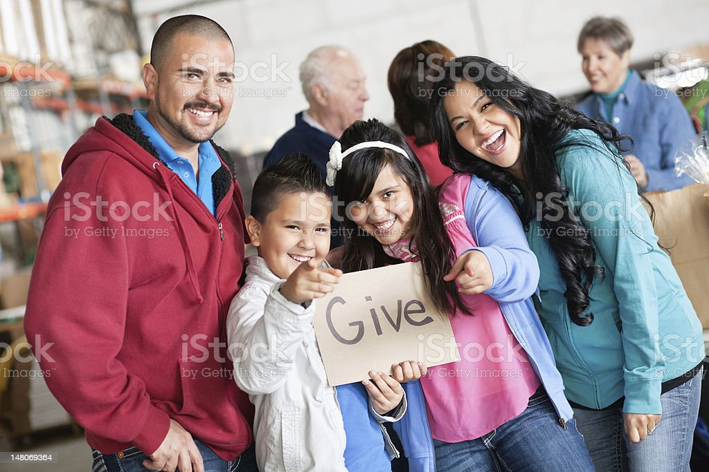 Family promoting giving at a donation drive royalty-free stock photo