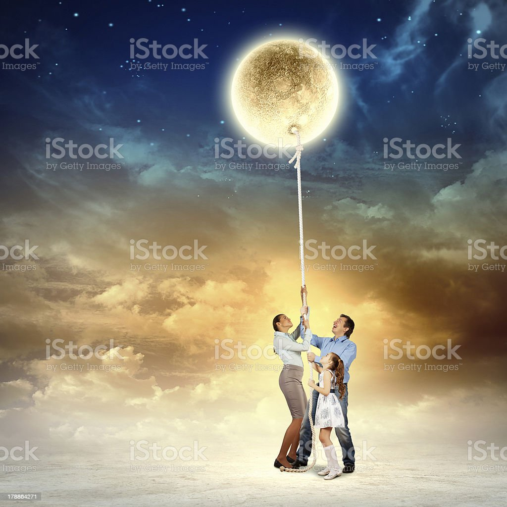 Family pulling moon royalty-free stock photo