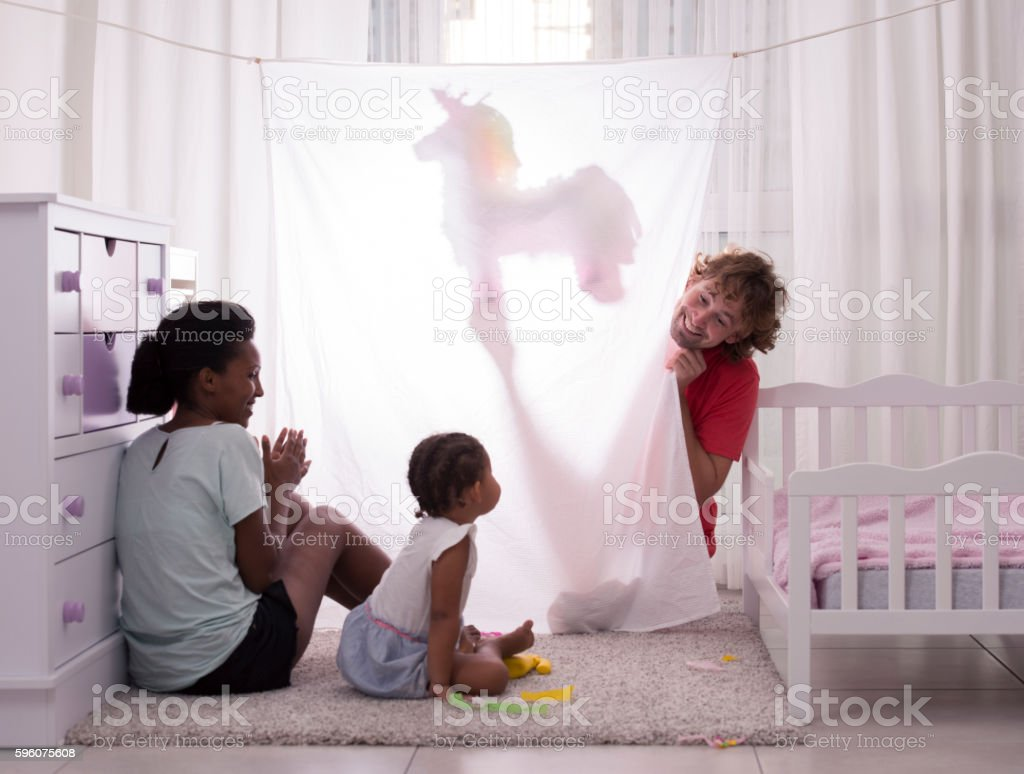 Family puppet show time. stock photo