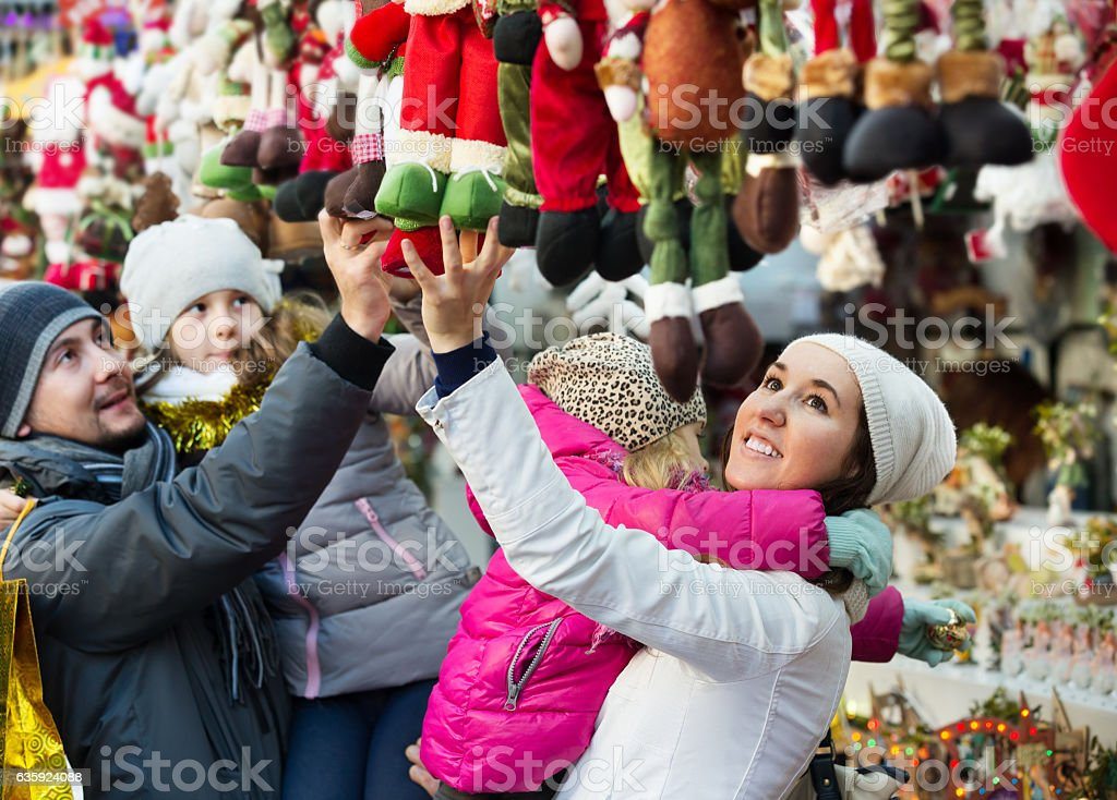 Family purchasing Christmas decoration and souvenirs stock photo