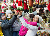Family purchasing Christmas decoration and souvenirs