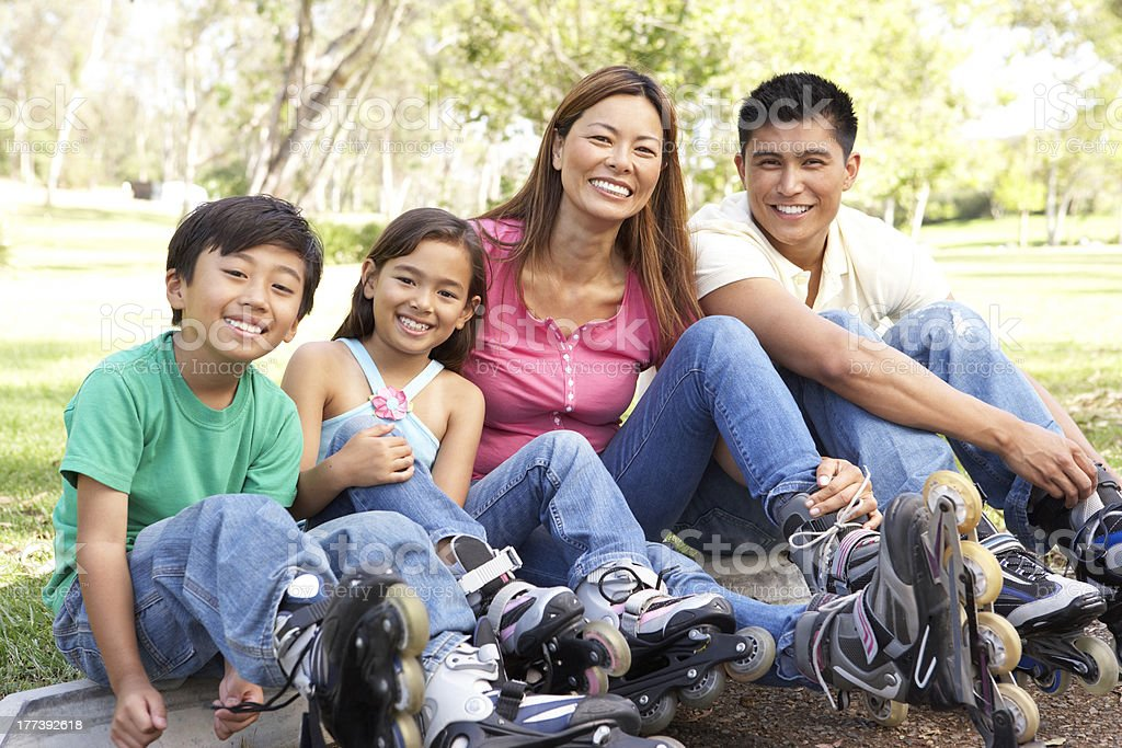 Family Putting On In Line Skates stock photo