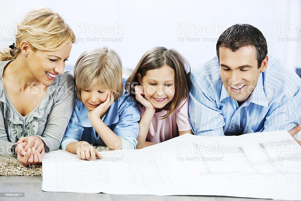 Family reading blueprints. royalty-free stock photo