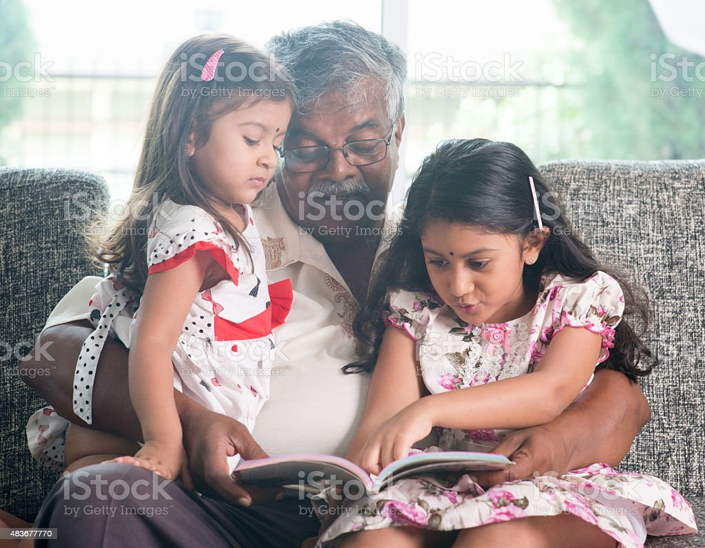 Family reading book together stock photo