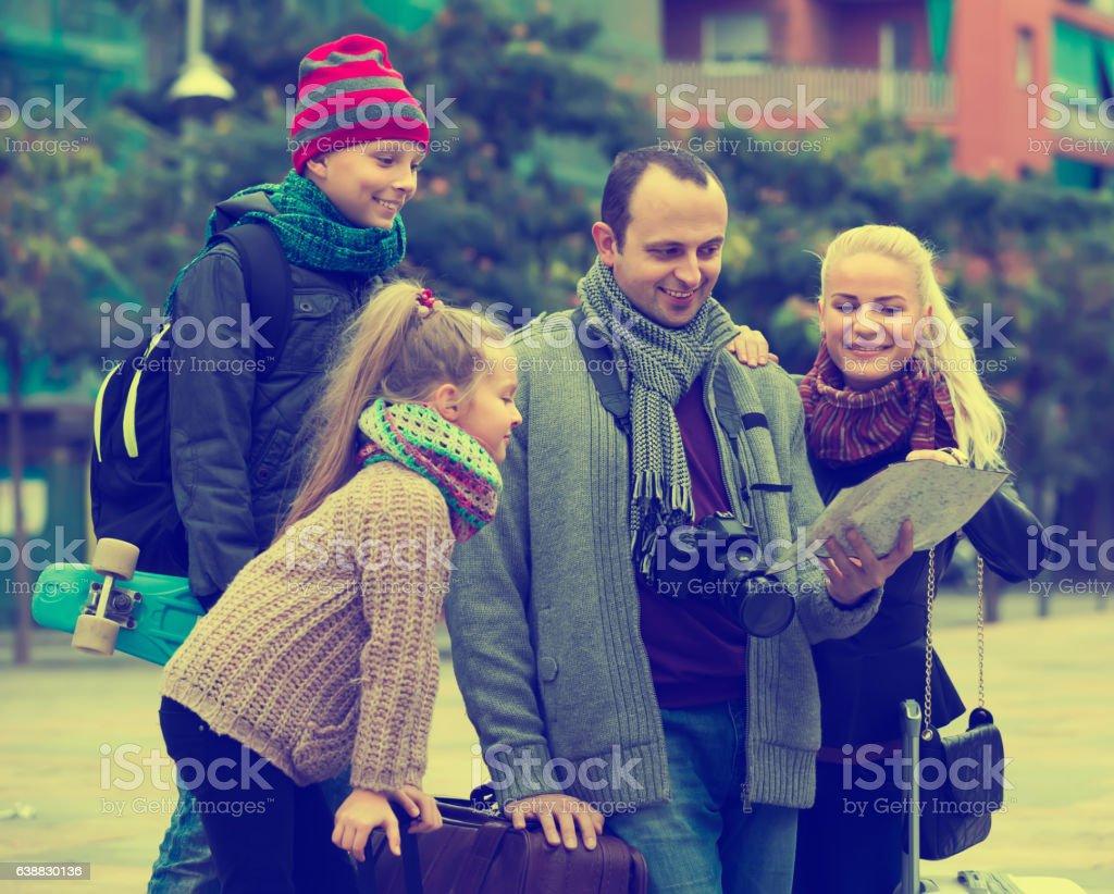 Family  reading city map stock photo