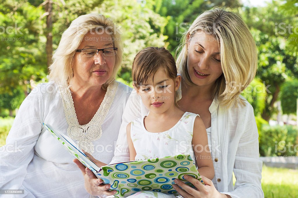 Family reading in the park royalty-free stock photo