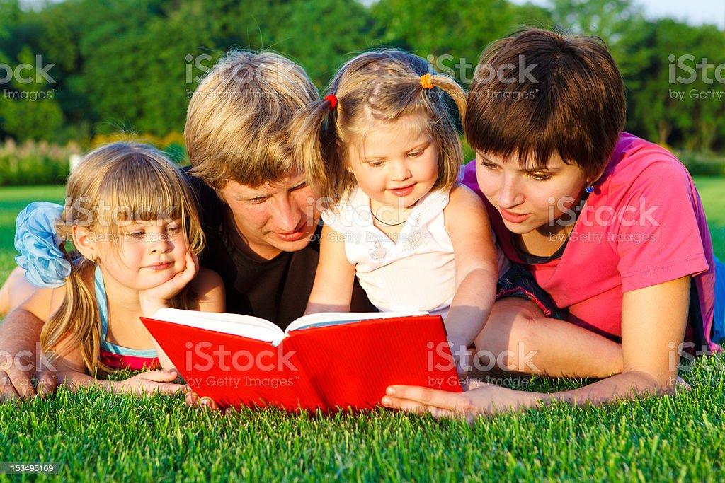 Family reading royalty-free stock photo