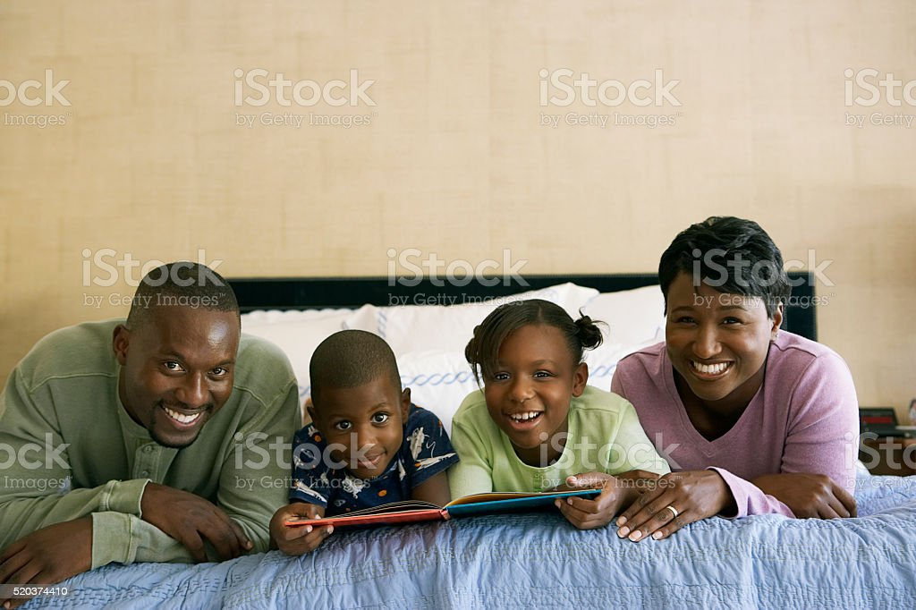 Family reading stories together stock photo