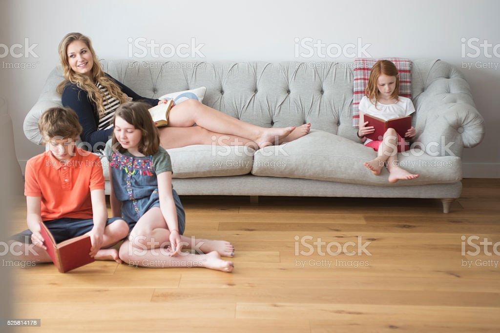 Family reading time stock photo