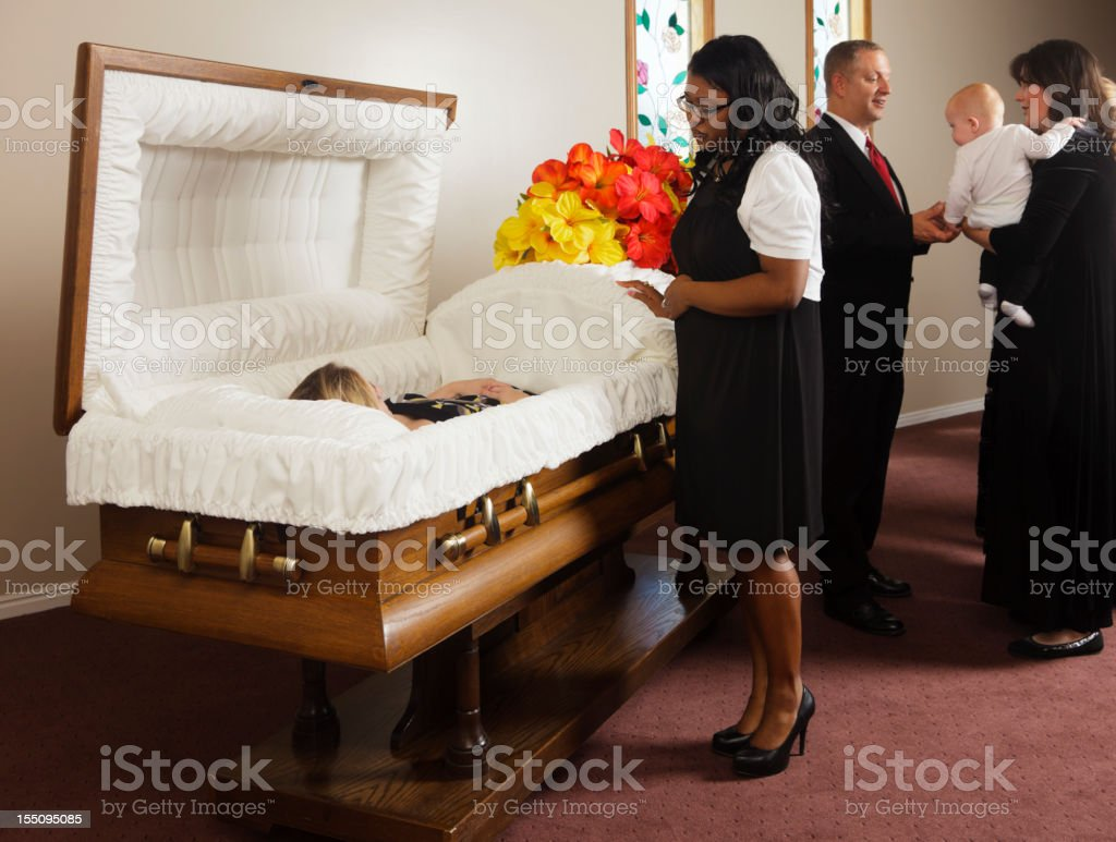 Family Receiving Guests at a Funeral stock photo