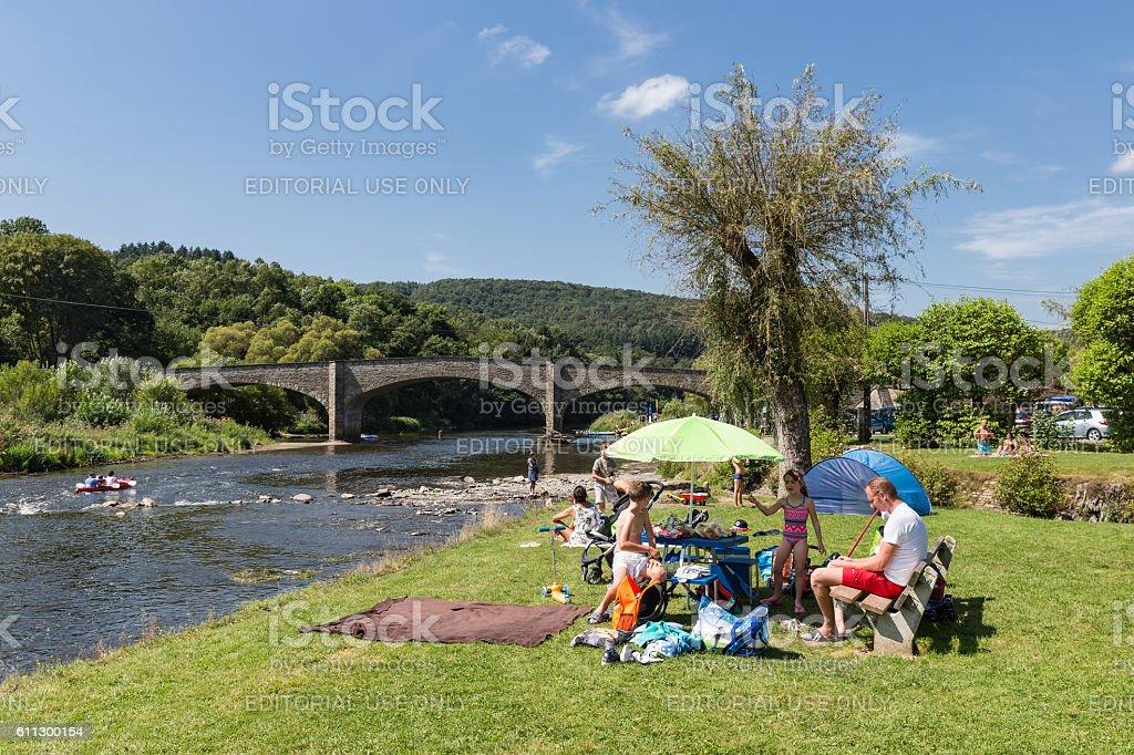 Family recreating near the riverside of the river Semois, Belgium stock photo