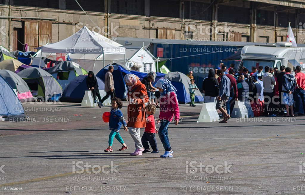 Family refugees in a camp for refugees stock photo