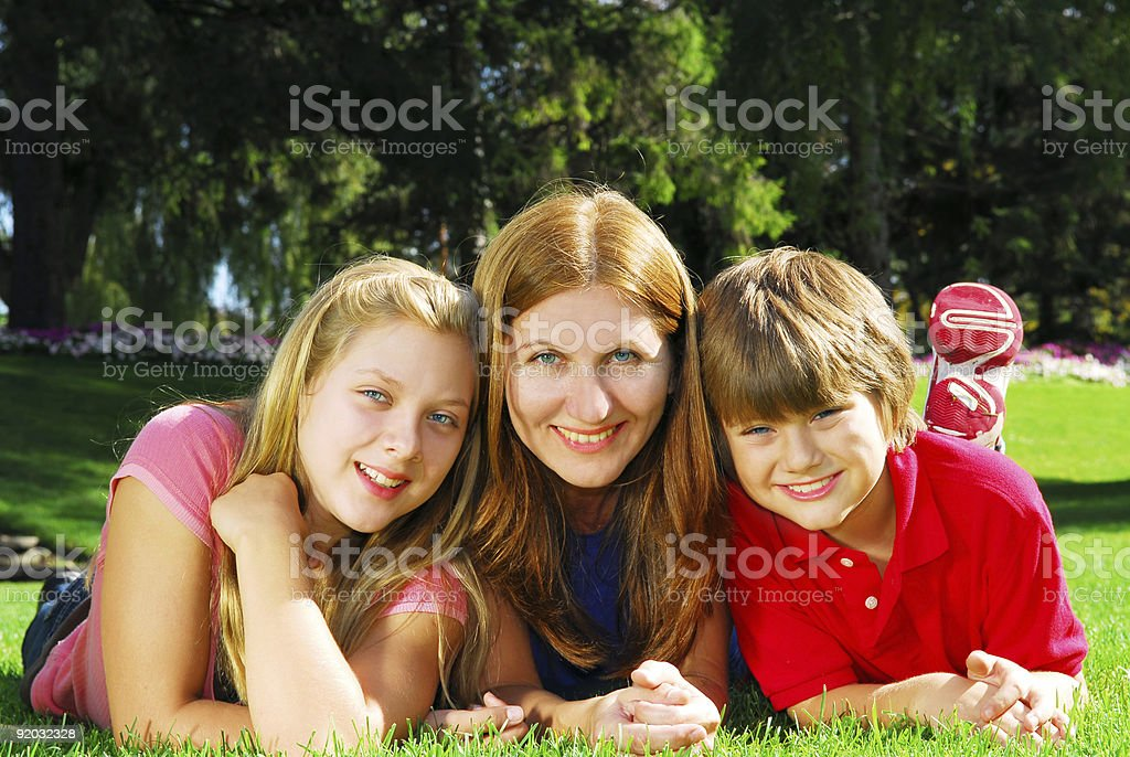 Family relaxing in a park royalty-free stock photo