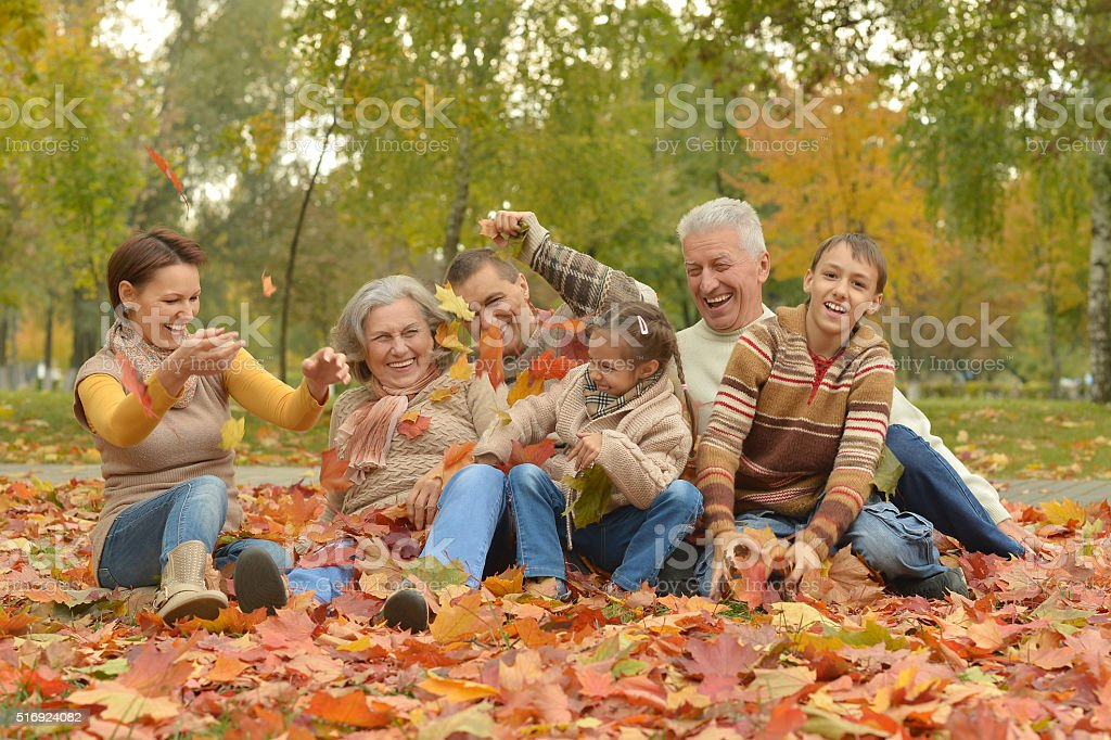 Family relaxing in autumn park stock photo